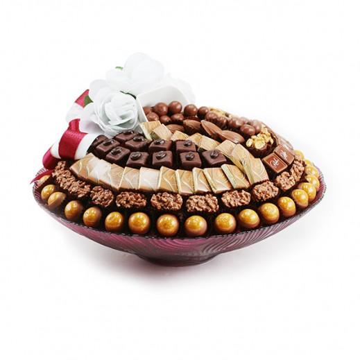 طبق شوكلاتة فاخرة من الزجاج الوردي دائري 1.25 كجم - يتم التوصيل بواسطة Chocolates Rohr Geneve