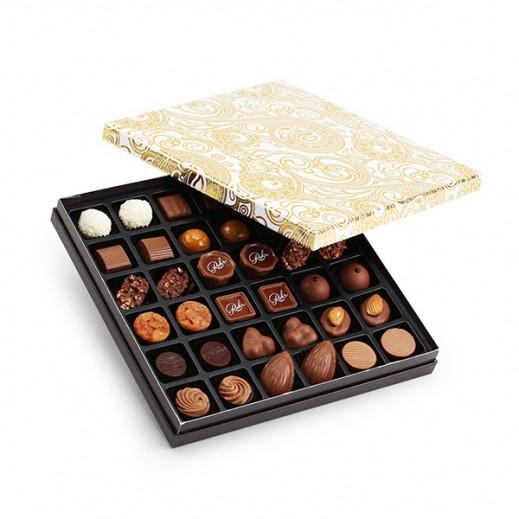 علبة شوكولاتة مُميزة 36 حبة - يتم التوصيل بواسطة Chocolates Rohr Geneve