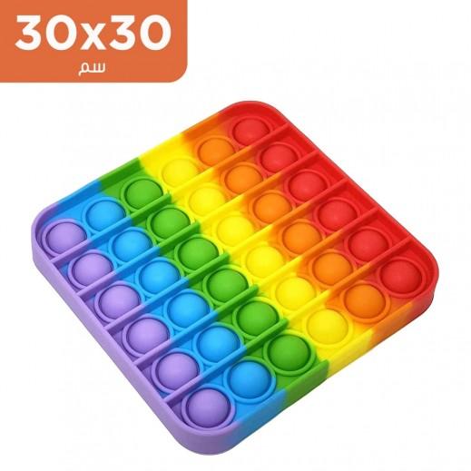 لعبة فقّاعات مربّعة لتخفيف التوتّر بألوان قوس القزح - حجم كبير (30 × 30 سم)