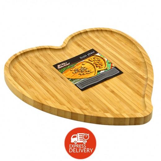 طبق خشبي على شكل قلب لتقديم الفواكه